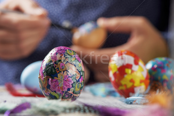 young man decorating easter eggs Stock photo © nito