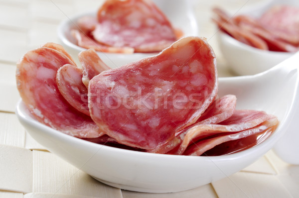 Stock photo: slices of fuet, spanish cured sausage