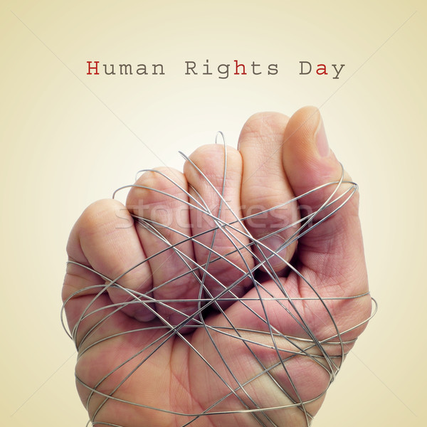 man hand tied with wire and the text human rights day Stock photo © nito