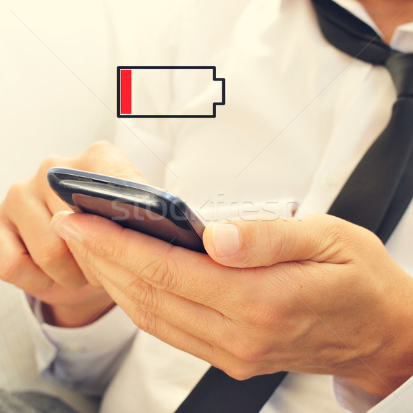 young man with a smartphone with low battery Stock photo © nito