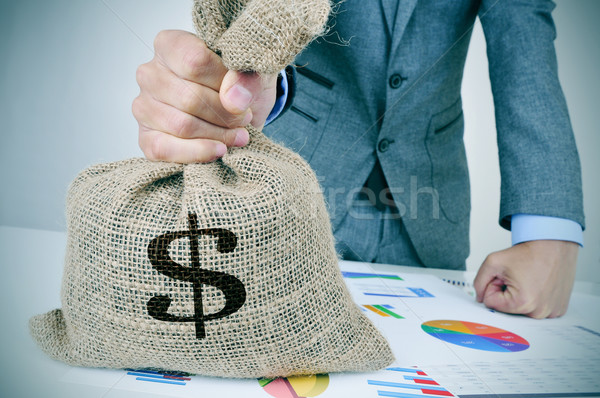 young man in suit with a money bag Stock photo © nito