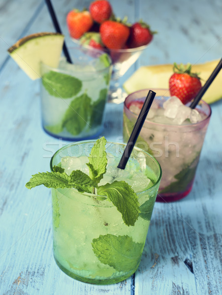 refreshing mojito on a rustic blue table Stock photo © nito