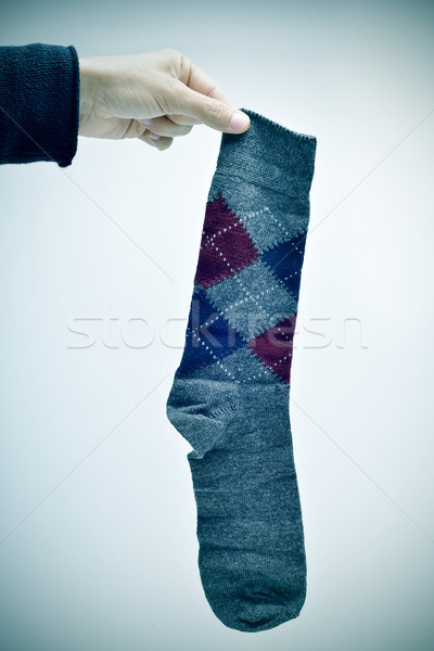 man holding an argyle patterned sock, vignetted Stock photo © nito