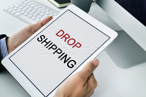 businessman with a tablet with the text drop shipping Stock photo © nito