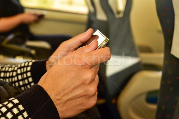 Fiatalember okostelefon vonat közelkép fiatal kaukázusi Stock fotó © nito