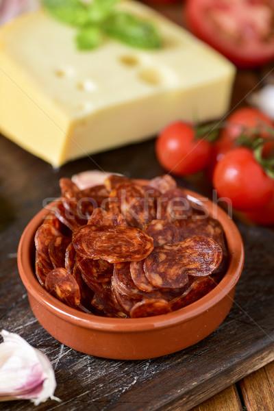 Szeletel spanyol chorizo fokhagyma paradicsom sajt Stock fotó © nito