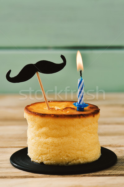 moustache and lit candle on a cheesecake Stock photo © nito