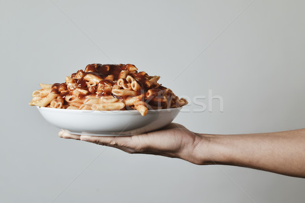 man with a plate of pasta with tomato sauce Stock photo © nito