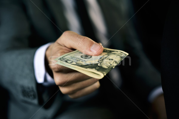 man with a wad of dollar bills in a car Stock photo © nito