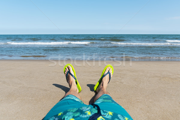 caucasian man relaxing on the beach Stock photo © nito