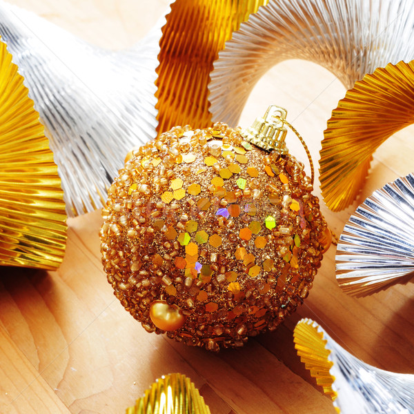 Stock photo: golden christmas ball and golden and silver garland