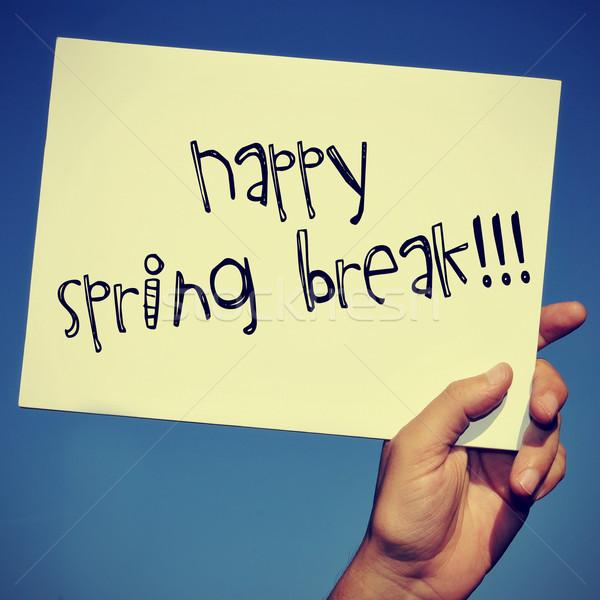 Boldog tavaszi szünet férfi kéz tart szöveg Stock fotó © nito