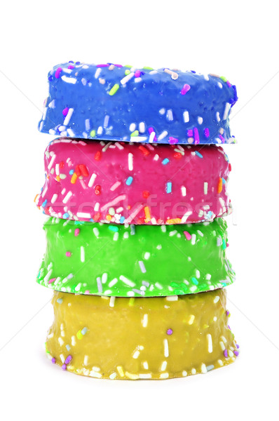 donuts coated with frosting and sprinkles of different colors Stock photo © nito
