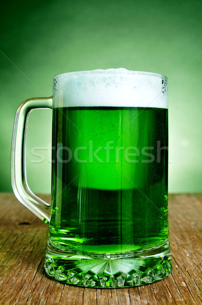 glass mug with dyed green beer Stock photo © nito