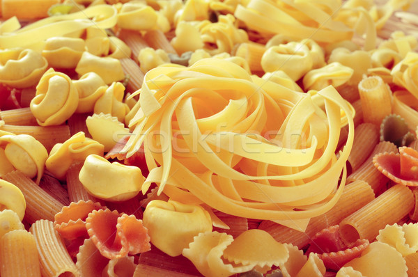 uncooked pasta, such as tortellini, tagliatelle or penne rigate Stock photo © nito