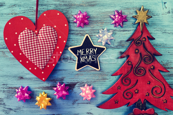 christmas ornaments and text merry xmas in a star-shaped chalkbo Stock photo © nito