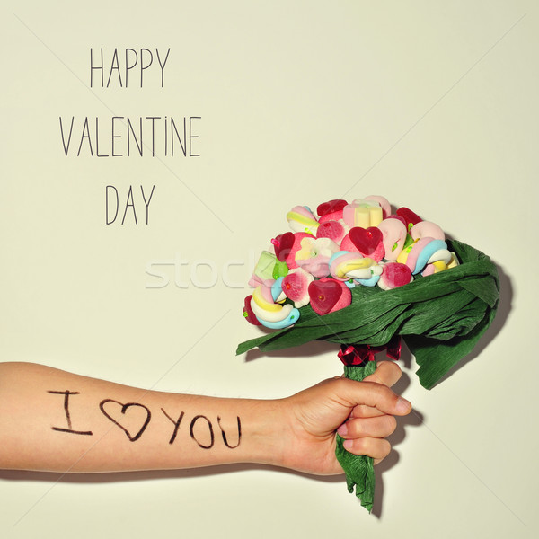 man offering a candy bouquet and text happy valentines day Stock photo © nito