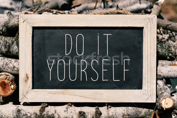 chalkboard with the text do it yourself Stock photo © nito