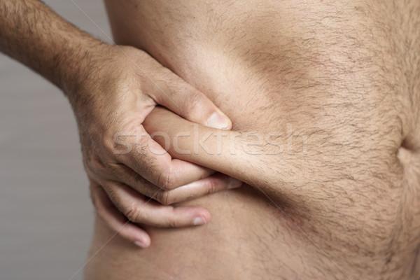 man grabbing the fat of his flank Stock photo © nito
