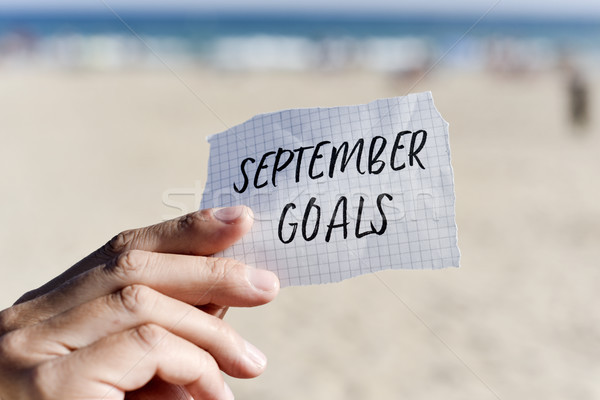 man with a note with the text september goals Stock photo © nito