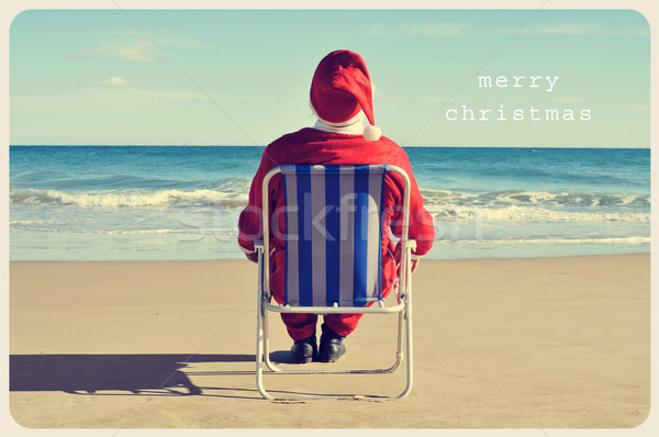 text merry christmas and santa claus on the beach Stock photo © nito