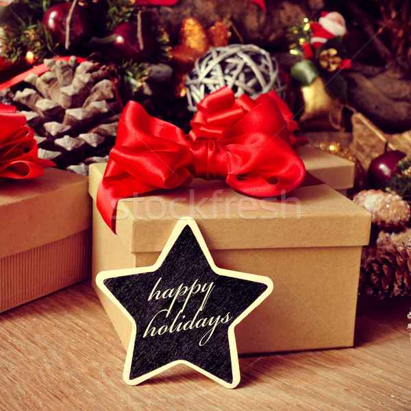gifts and text happy holidays in a star-shaped chalkboard Stock photo © nito