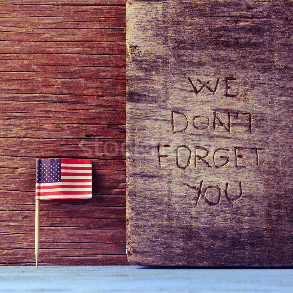Stock photo: text we do not forget you carved on wood