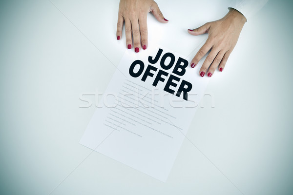 businesswoman shows a document with the text job offer Stock photo © nito