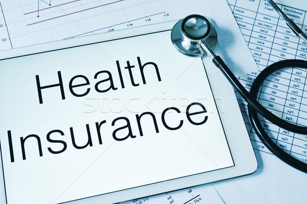 Sztetoszkóp szöveg egészségbiztosítás képernyő tabletta táblagép Stock fotó © nito