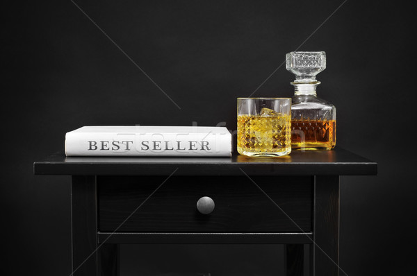 bottle with liquor and book with the text best seller Stock photo © nito