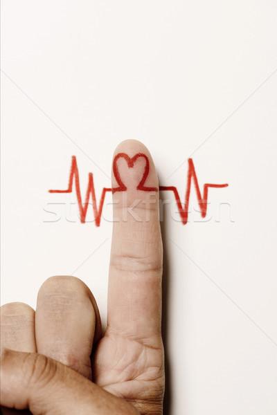 Kalp simge işaret parmağı adam kırmızı elektrokardiyogram Stok fotoğraf © nito