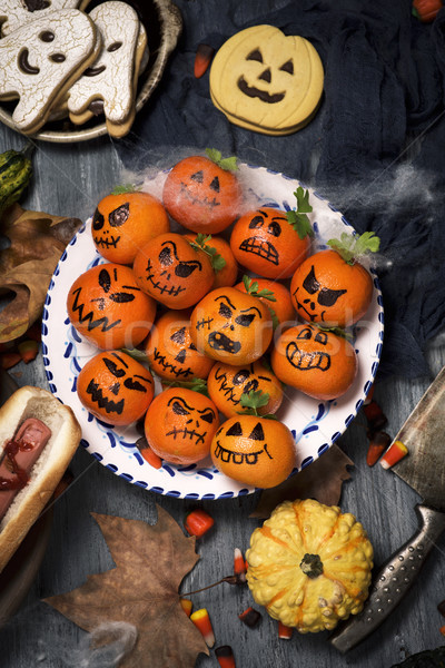 funny halloween food on a rustic table Stock photo © nito