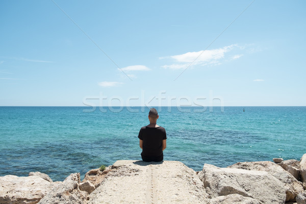 man sitting in front of the sea Stock photo © nito