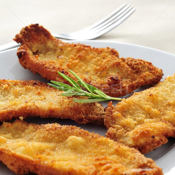 spanish escalopa de pollo a la milanesa, breaded chicken fillets Stock photo © nito