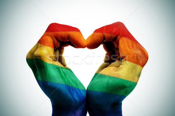 Homo liefde man handen regenboog vlag Stockfoto © nito