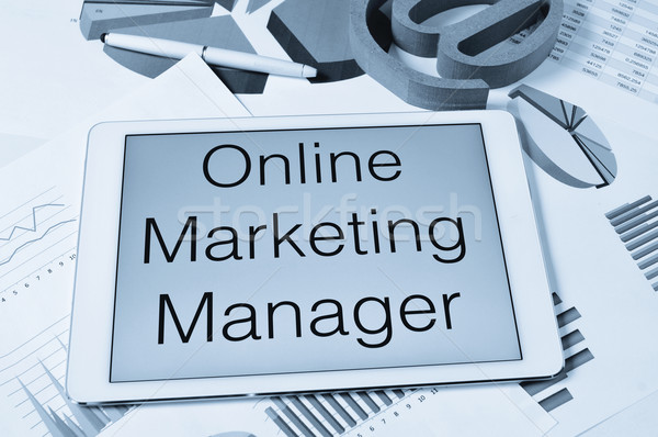 text online marketing manager in the screen of a tablet Stock photo © nito