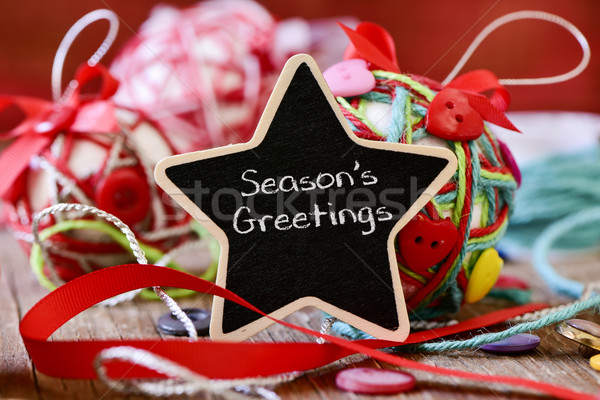 star-shaped chalkboard with the text seasons greetings Stock photo © nito