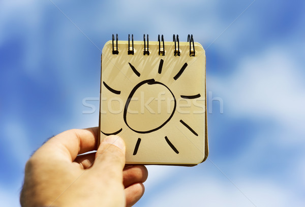 man and a sun in a notepad Stock photo © nito