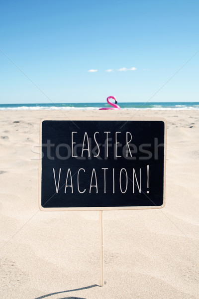 text easter vacation in a signboard on the beach Stock photo © nito