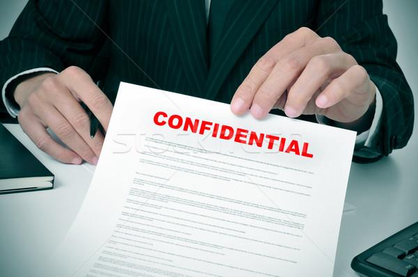 конфиденциальный человека костюм документа Сток-фото © nito