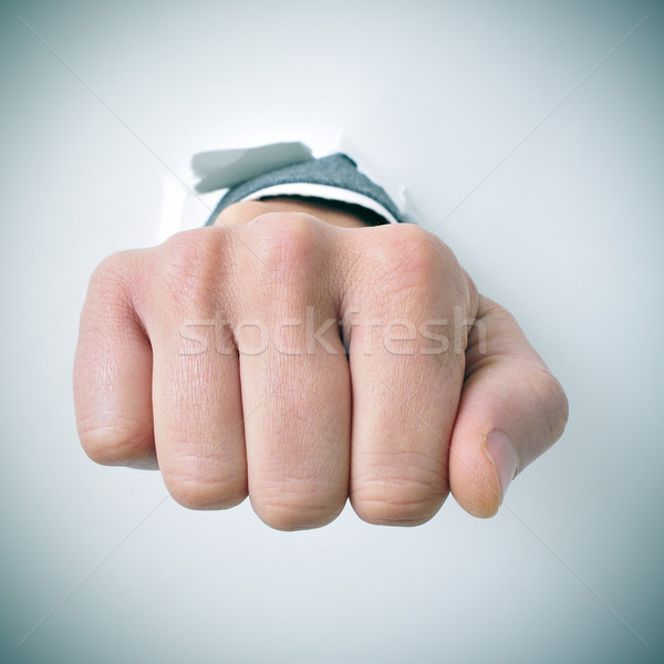 businessman breaks through a wall with his fist Stock photo © nito