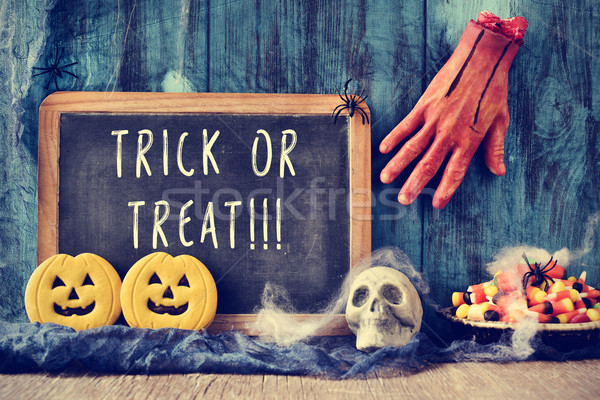 chalkboard with the text trick or treat in a halloween scene Stock photo © nito