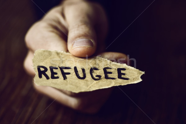 Peça papel palavra refugiado mão Foto stock © nito