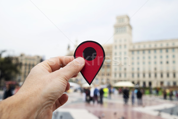 man with red marker in Placa Catalunya, Barcelona