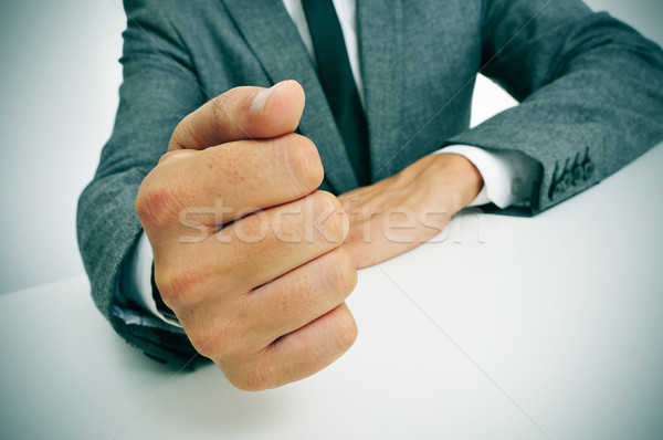 man in suit banging his fist on the desk Stock photo © nito