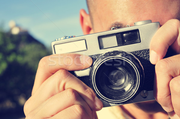 young man taking a picture with an old camera Stock photo © nito