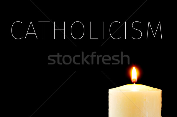 a lit candle and the word Catholicism Stock photo © nito