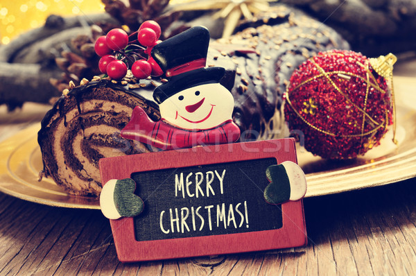 yule log cake and chalkboard with text merry christmas Stock photo © nito