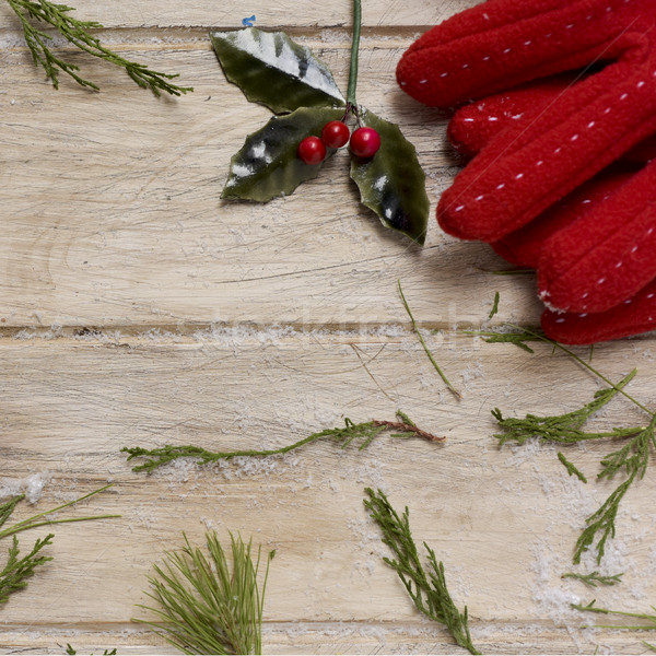 red gloves and holly on a wooden surface Stock photo © nito