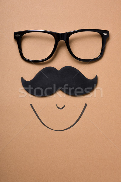 eyeglasses and mustache forming a face Stock photo © nito